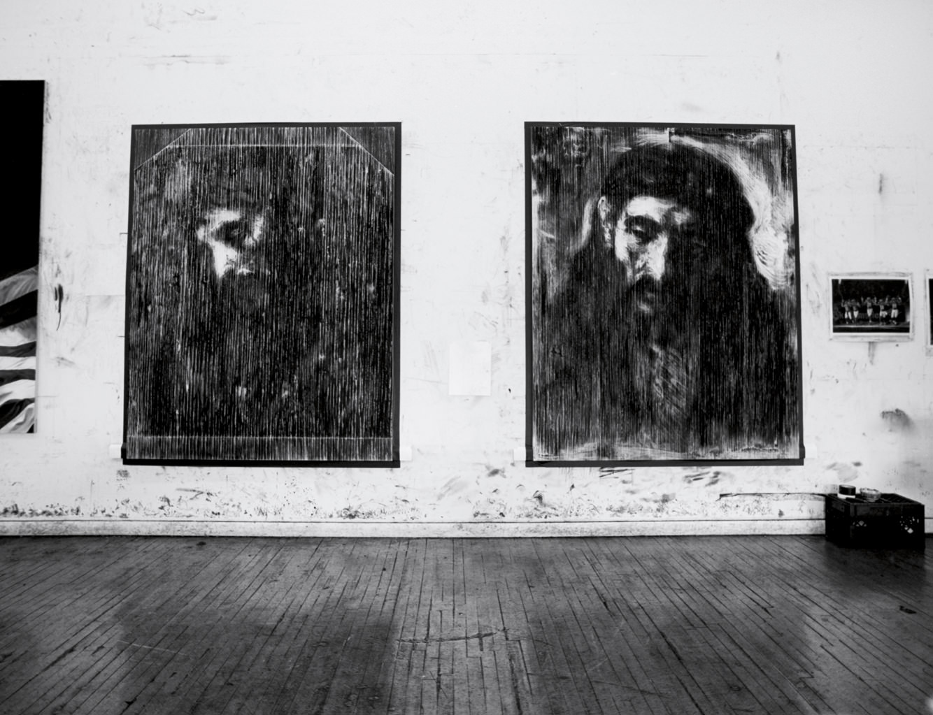 View of the studio. These Robert Longo works were made after representations of Jesus Chris drawn by Rembrandt.