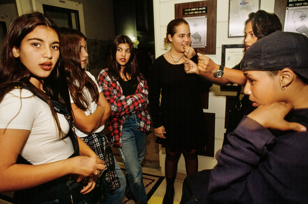 Kim Kardashian, 12, and her sister Kourtney (third from left), 13, at a school dance in Bel-Air, Los Angeles, 1992. Keeping Up with the Kardashians debuted in 2007. By 2016, according to Forbes, the show had made the family the world's highest-earning reality TV stars, with a combined total income that year of $122.5 million.
