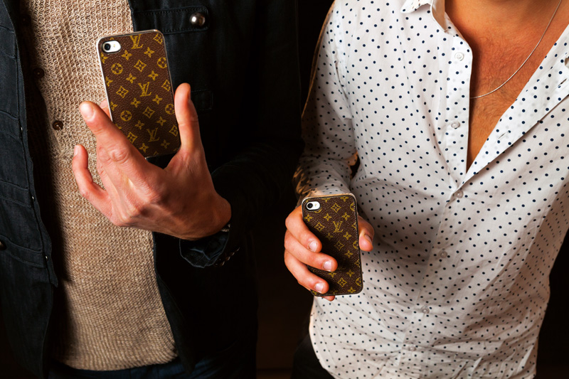 Bachelors and best friends Ariano, 26, and Lucas, 23, show off their Louis Vuitton phone cases on a night out to pick up women at Marquee Las Vegas, a club where a table reservation can require a minimum spend of $10,000, 2012.