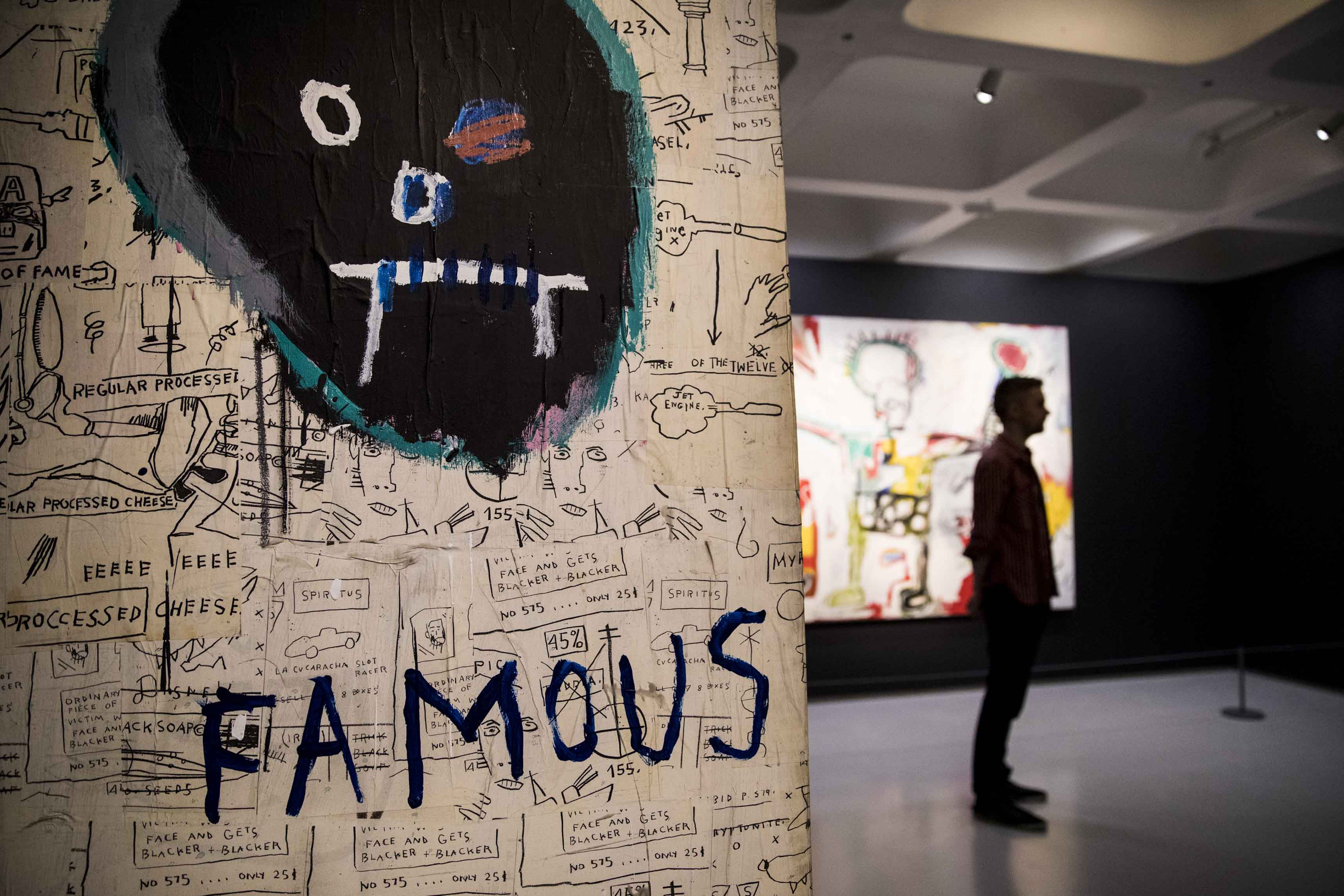 Basquiat: Boom For Real Installation view Barbican Art Gallery 21 September 2017 – 28 January 2018 © Tristan Fewings / Getty Images Artwork: Jean-Michel Basquiat, Famous, 1982 Private collection. Courtesy of Lio Malca, New York © The Estate of Jean-Michel Basquiat. Licensed by Artestar, New York