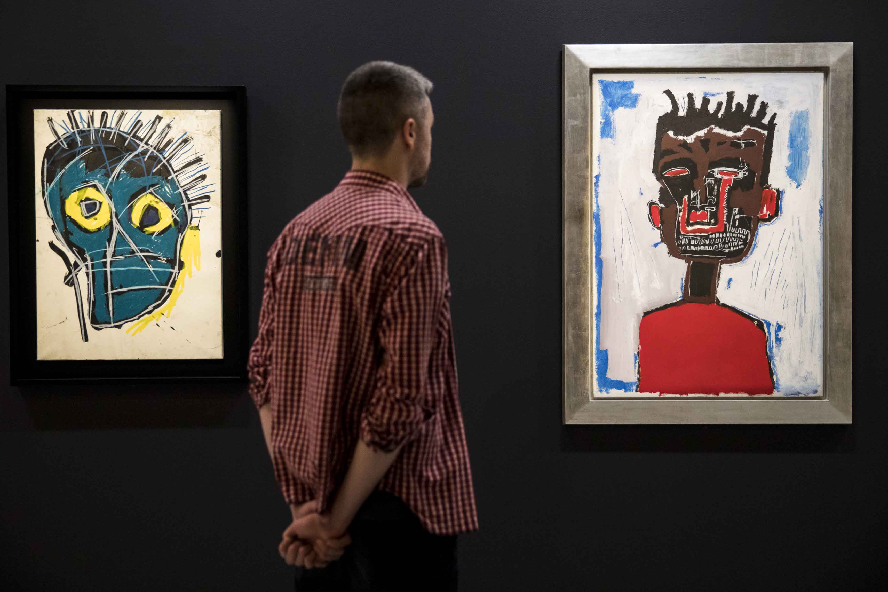 Basquiat: Boom For Real Installation view Barbican Art Gallery 21 September 2017 – 28 January 2018 © Tristan Fewings / Getty Images Artworks (left to right): Jean-Michel Basquiat, Untitled, 1983 W&K – Wienerroither & Kohlbacher, Vienna © The Estate of Jean-Michel Basquiat. Licensed by Artestar, New York. Courtesy W&K – Wienerroither & Kohlbacher, Vienna. Jean-Michel Basquiat, Self Portrait, 1984 Private collection. © The Estate of Jean-Michel Basquiat. Licensed by Artestar, New York.