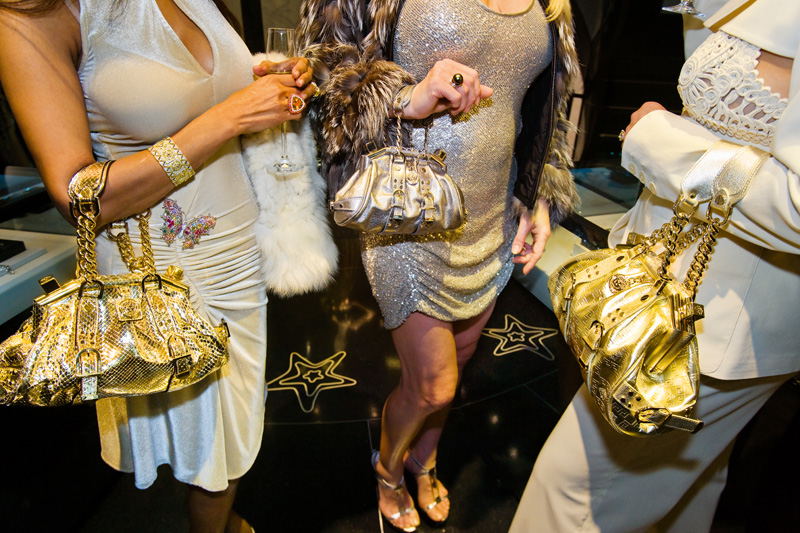 Jackie and friends with Versace handbags at a private opening at the Versace store, Beverly Hills, 2007. A Versace devotee, Jackie shopped from monthly shipments of new merchandise that the design house sent to her home.