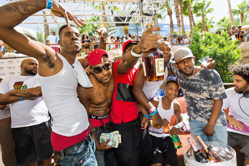 Hip-hop artist Kendrick Lamar (right, standing), 27, with friends at the Rehab Beach Club at the Hard Rock Hotel & Casino, Las Vegas, 2014. The former straight-A student from Compton, California, has won seven Grammy Awards, including Best Rap Album in 2016 for the highly acclaimed To Pimp a Butterfly. That year, Time included him on its annual list of the one hundred most influential people in the world.
