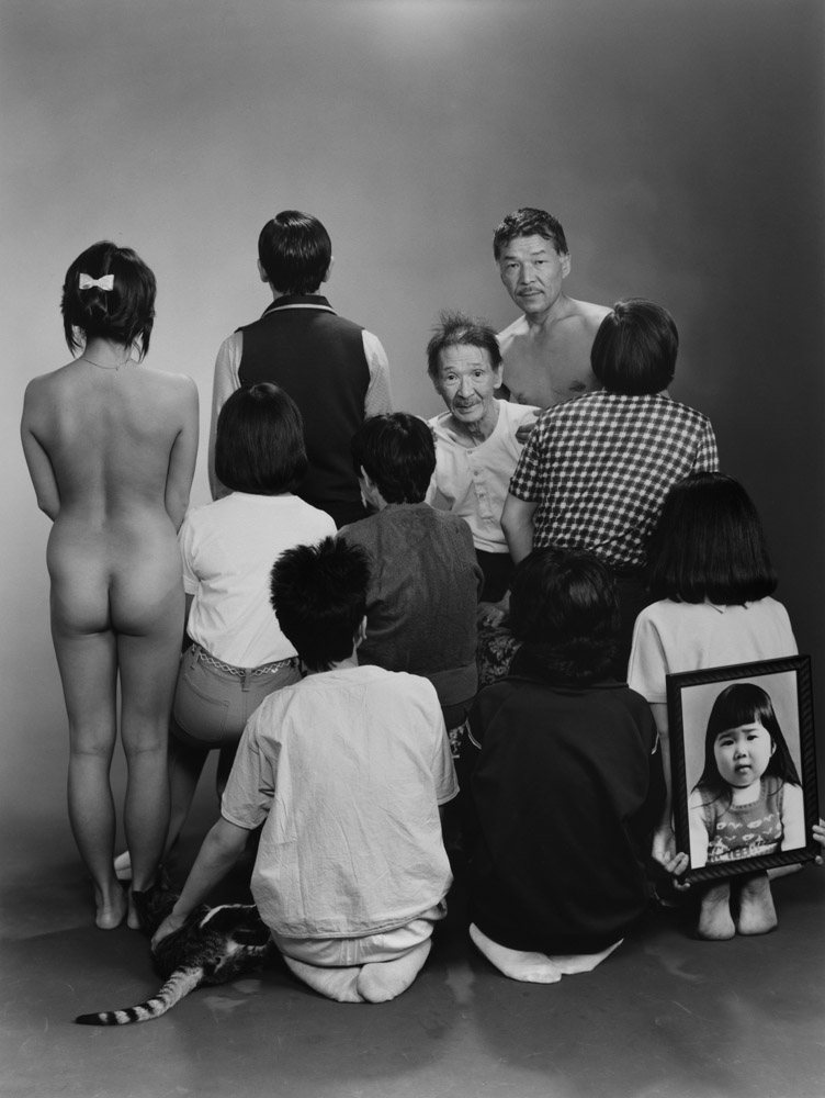 """Upper row, from left to right: A, a model; Toshiteru, Sukezo, Masahisa. Middle row"", from left to right: Akiko, Mitsue, Hisashi Daikoji. Bottom row, from left to right: Gaku, Kyoko, Kanako, and a memorial portrait of Miyako, 1985, from the series ""Family"", 1971-90"", Masahisa Fukase, © Masahisa Fukase Archives"