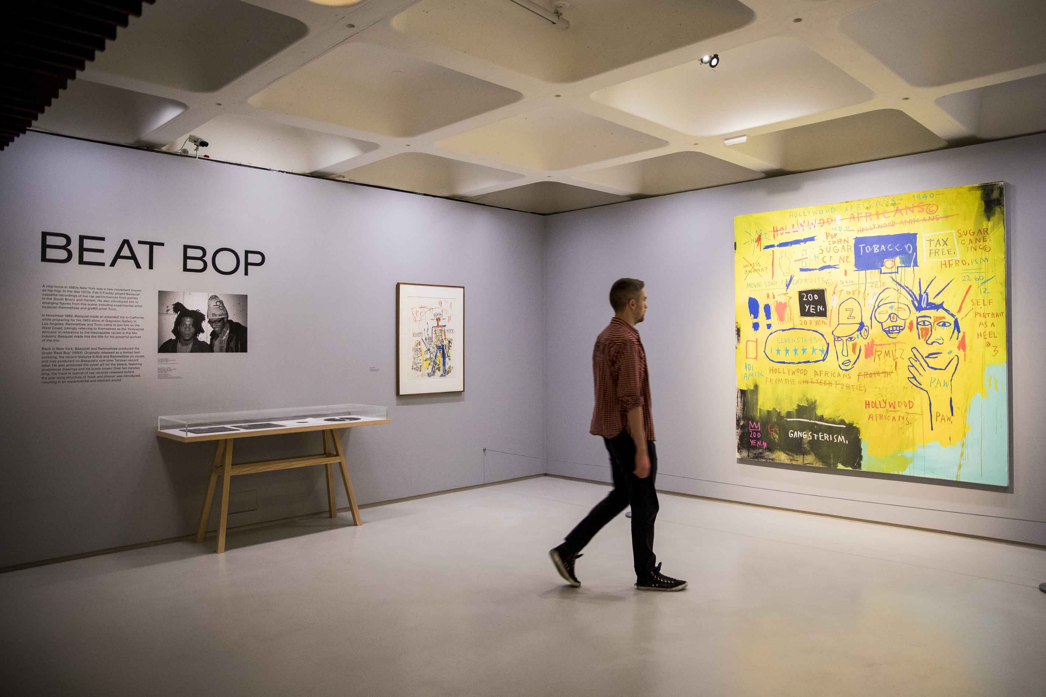 Basquiat: Boom For Real Installation view Barbican Art Gallery 21 September 2017 – 28 January 2018 © Tristan Fewings / Getty Images Artwork: Jean-Michel Basquiat, Hollywood Africans, 1983 Courtesy Whitney Museum of American Art, New York. © The Estate of Jean-Michel Basquiat/ Artists Rights Society (ARS), New York/ ADAGP, Paris. Licensed by Artestar, New York.