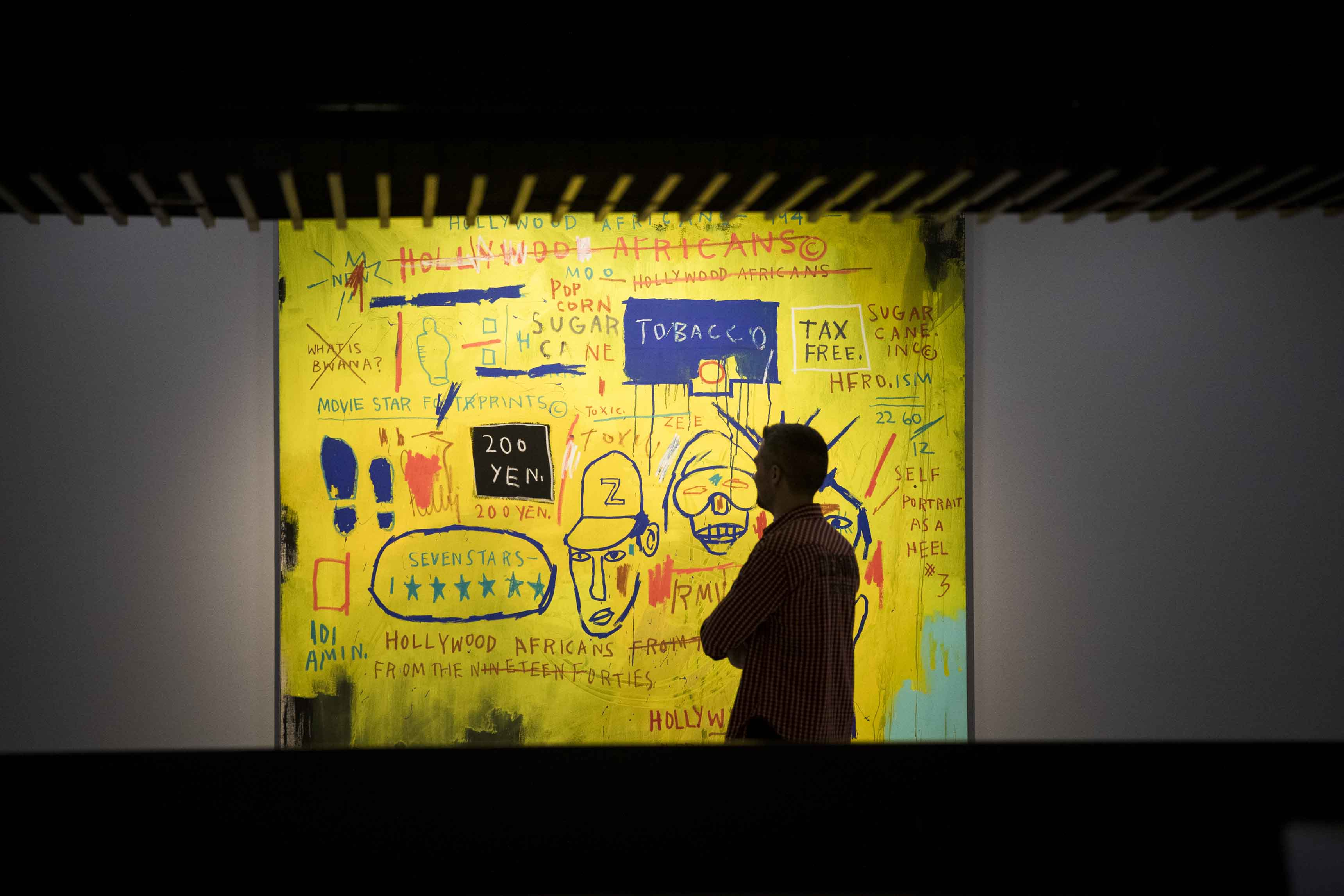 Basquiat: Boom For Real Installation view Barbican Art Gallery 21 September 2017 – 28 January 2018 © Tristan Fewings / Getty Images Artwork: Jean-Michel Basquiat, Hollywood Africans, 1983 Courtesy Whitney Museum of American Art, New York. © The Estate of Jean-Michel Basquiat/ Artists Rights Society (ARS), New York/ ADAGP, Paris. Licensed by Artestar, New York..