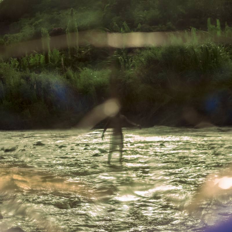 Isadora Romero, A man seems to float on the Mascarilla River in the Chota Valley in Ecuador. During the weekend, families take advantage of the morning to bathe and play in the river. © Isadora Romero