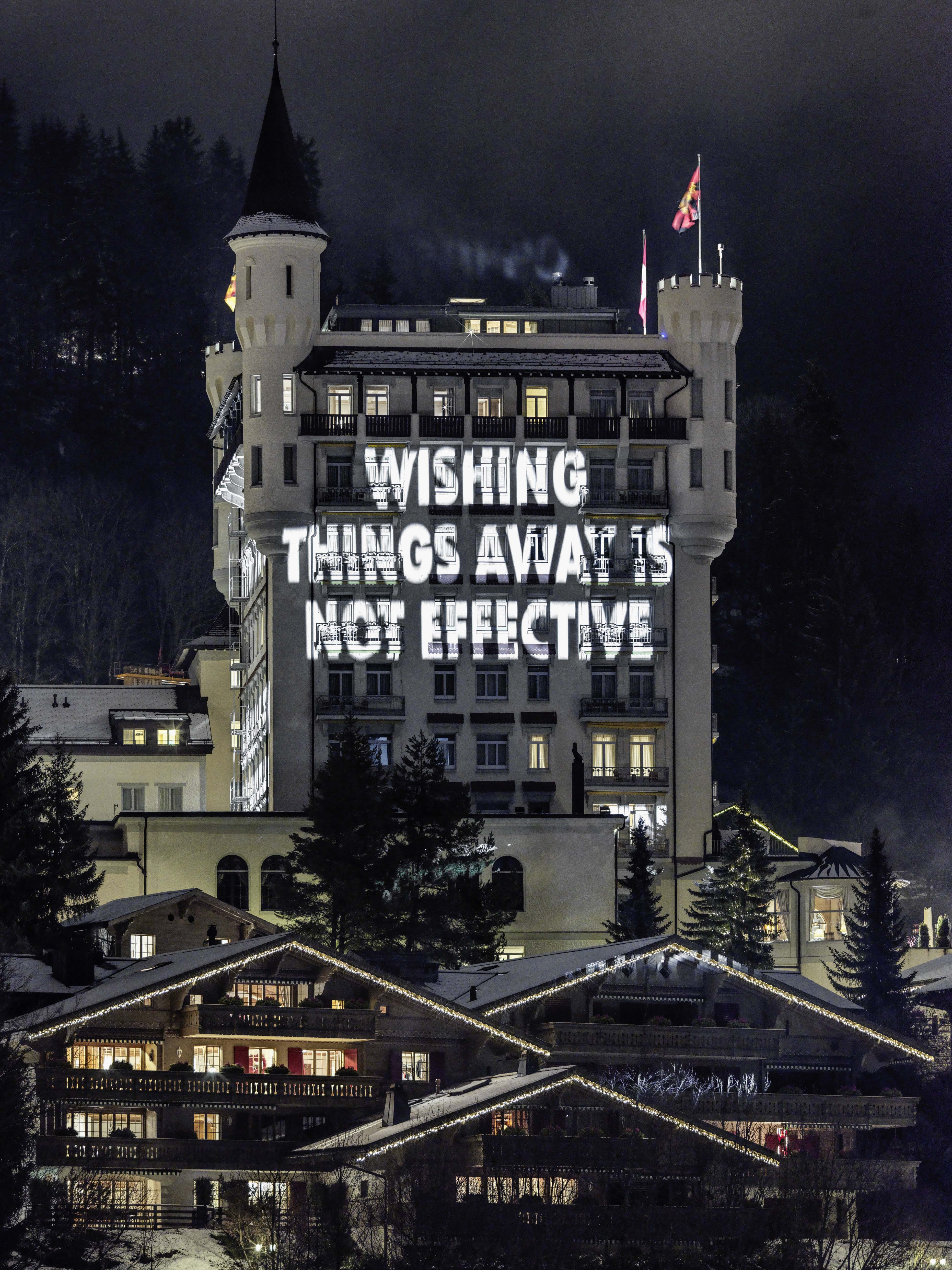 """Jenny Holzer, """"A LITTLE KNOWLEDGE CAN GO A LONG WAY"""" (2019). Light projections on the Gstaad Palace © Jenny Holzer. ARS, NY and DACS, London 2019. Courtesy the artist and Hauser & Wirth"""