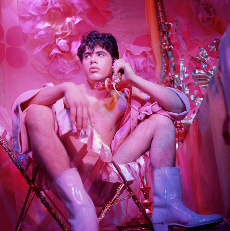James Bidgood, Bobby Kendall Seated in Chair Holding Phone, mid 1960s, digital C-Print. Courtesy of ClampArt, New York