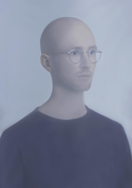 Jeune homme aux lunettes rondes. © Charlotte Mano #mode