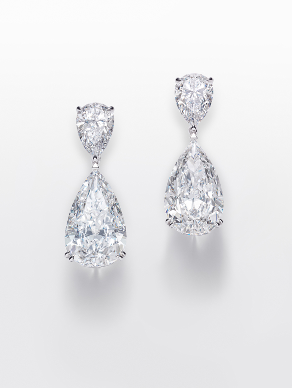 Earrings in 18ct white gold each featuring two exceptional pear-shaped diamonds of 3cts and 10.3cts.