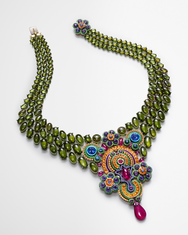 Necklace in 18ct yellow gold and titanium composed of tourmalines (for a total of 142cts), rubellites (14.3cts), Spessartine garnets (9.8cts), tanzanites (6.8cts), amethysts (5.5cts), tsavorites (4.1cts) and colored sapphires.