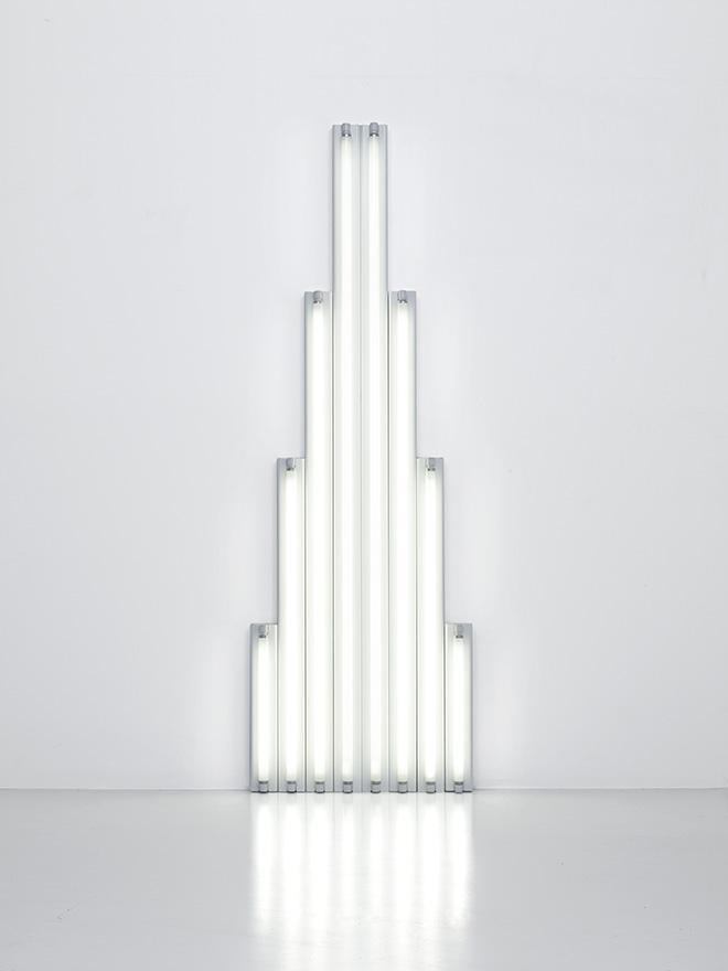 """""""Monument"""" for V. Tatlin, 1964-1965  Set of 8 white fluorescent tubes 244 x 80 x 12 cm Courtesy Fondation Louis Vuitton. Photo credit: © Adagp, Paris 2017"""