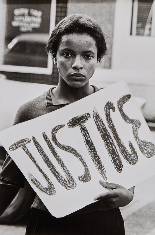 "Declan Haun, ""Justice, Protestor in the Monroe Action Committee"", N.C 1963 Gelatin silver print, printed later. 13 5/8 x 9 1/8 in. (34.6 x 23.2 cm) 'Black Star' agency credit stamp on the verso. Estimate :  $ 3,000 - 5,000"
