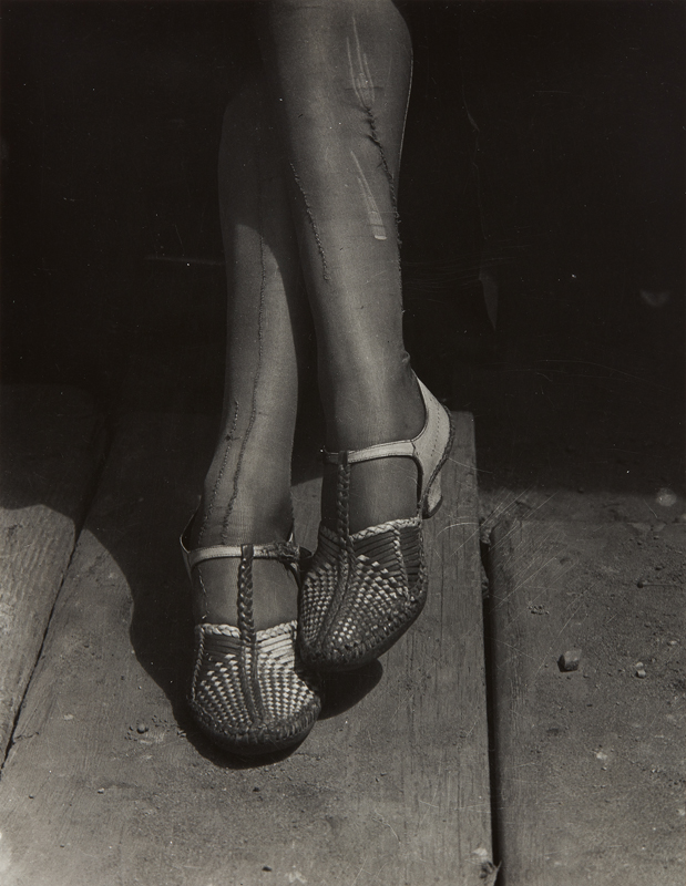 "Dorothea Lange ""A Sign of the Times–Mended Stockings, Stenographer, San Francisco""  1934 Gelatin silver print, probably printed in the 1950s or 1960s. 9 1/2 x 7 3/8 in. (24.1 x 18.7 cm) Printing notations in an unidentified hand in pencil on the verso. Estimate :  $ 18,000 - 22,000"