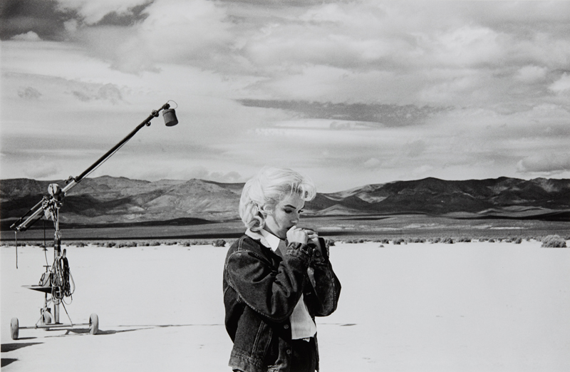 "Eve Arnold ""Marilyn on the set of 'The Misfits,' Nevada"" 1960 Gelatin silver print, printed later. 12 3/8 x 18 7/8 in. (31.4 x 47.9 cm)"