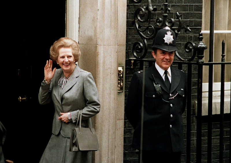 Margaret Thatcher outside 10 Downing Street with Asprey handbag, following a meeting with the Queen, 1987. Photo Credit John Redman/AP Shutterstock