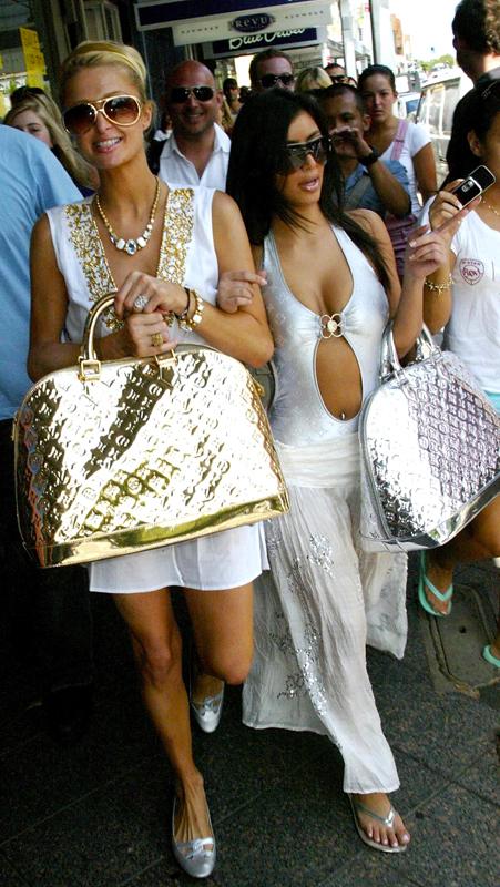 Paris Hilton and Kim Kardashian with Marc Jacobs for Louis Vuitton 'Monogram Miroir' gold speedy handbags in Sydney, Australia, 2006. Photo by PhotoNews International Inc/Getty Images