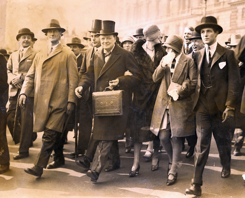 Winston Churchill, Chancellor of the Exchequer, carries the despatch box on his way to the House of Commons, in London, to present the budget, April 29, 1929. Photo Credit Bettman/Getty