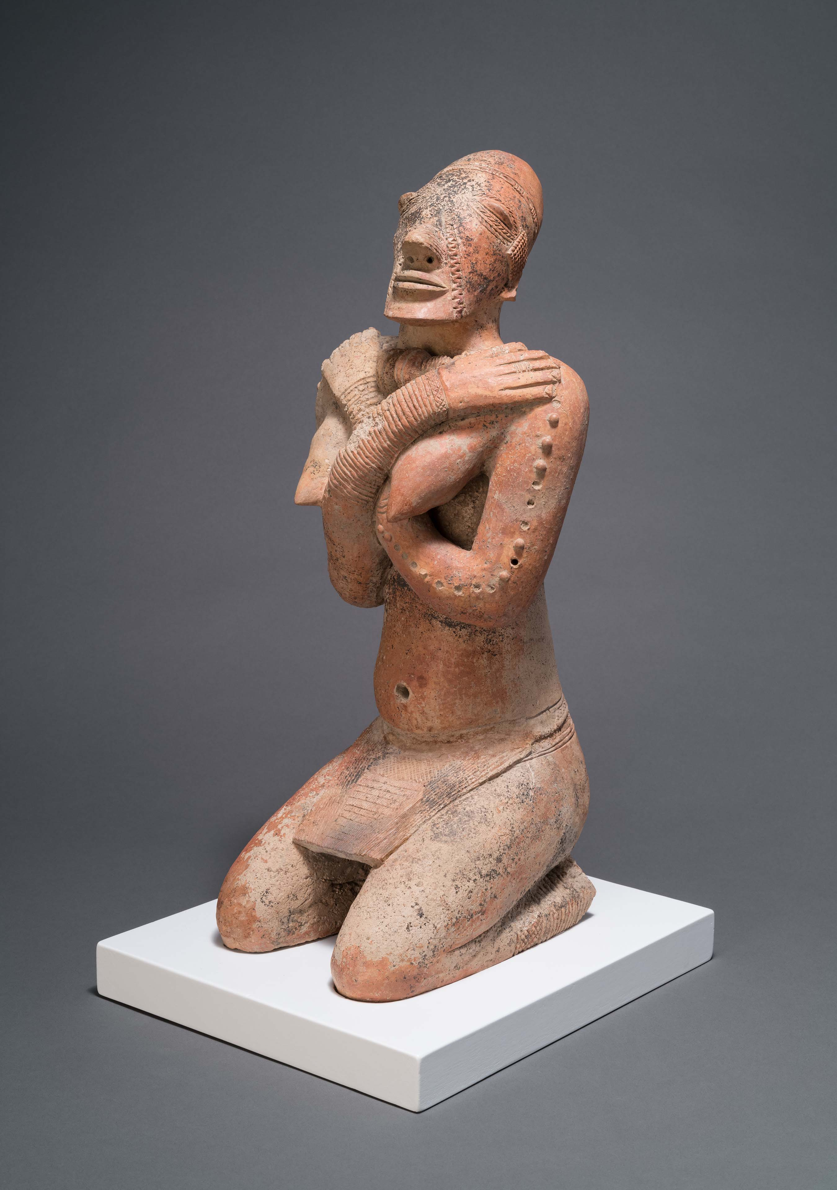 Kneeling Female Figure with Crossed Arms, Middle Niger civilization, Mali 12th–14th century, Photo credit: Courtesy Menil Collection