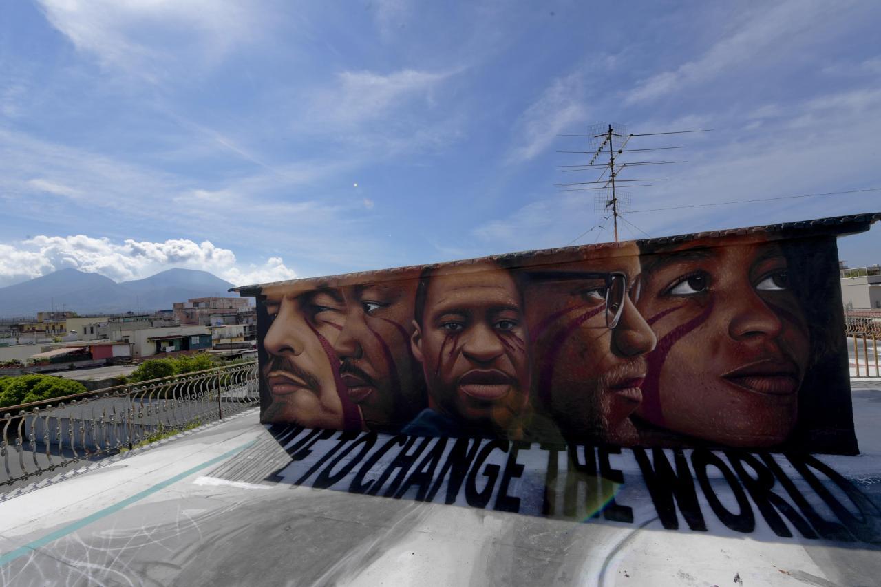 A mural by artist Jorit Agoch in Naples, Italy. CIRO FUSCO/EPA-EFE/Shutterstock