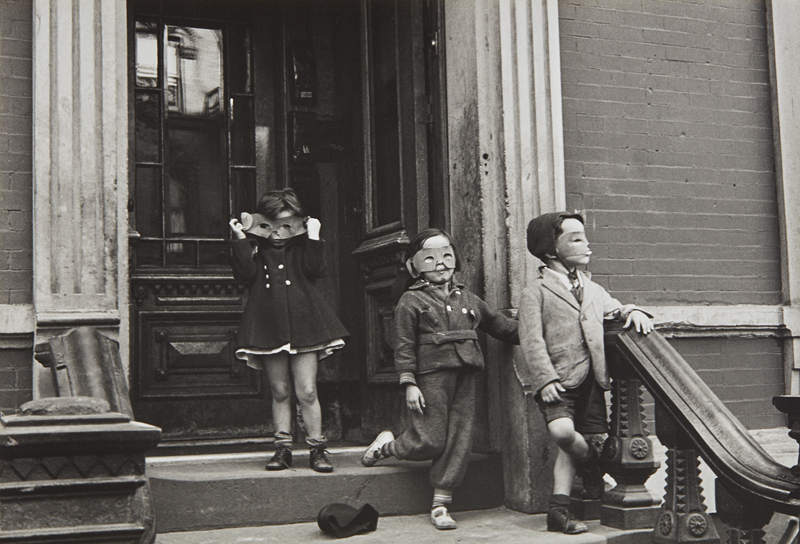 "Helen Levitt ""N.Y. (masked children on stoop)"" circa 1940 Gelatin silver print, printed later. 8 x 11 5/8 in. (20.3 x 29.5 cm)"