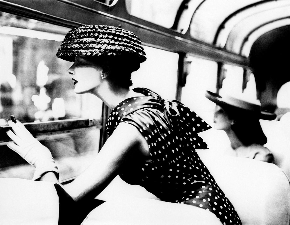 "Lillian Bassman, ""More Fashion Mileage Per Dress, Barbara Vaughn, dress by Filcol"", New York (1954). Gelatin silver print, printed later. 66.7 x 87.6 cm"