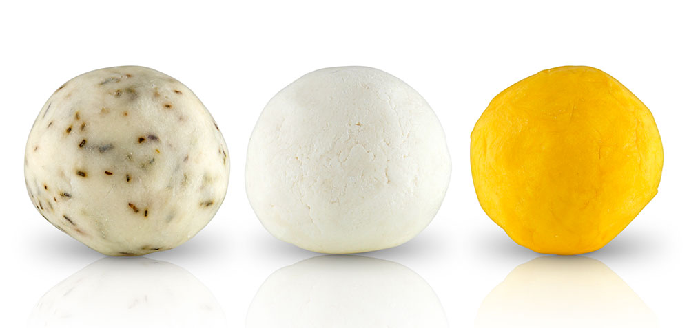 """The collection based on Siberian herbs is now offering three artisanal soaps. Based on juniper oil (anti-irritations) and propolis (antiseptic and antibacterial), the yellow version is for oily skin prone to breakouts. Paired with larch tree extracts, the beeswax version with Siberian pine and sea buckthorn has protecting and nourishing values. As white as snow, the version that already exists capitalises on the virtues of alchemilla and cladonia to combat signs of aging and to soften the skin. """"Natural Propolis Soap"""", """"Natural Pine Soap"""" and """"Natural Snow Soap"""", Natura Siberica. 7 euros, 100g. On sale at Monoprix."""