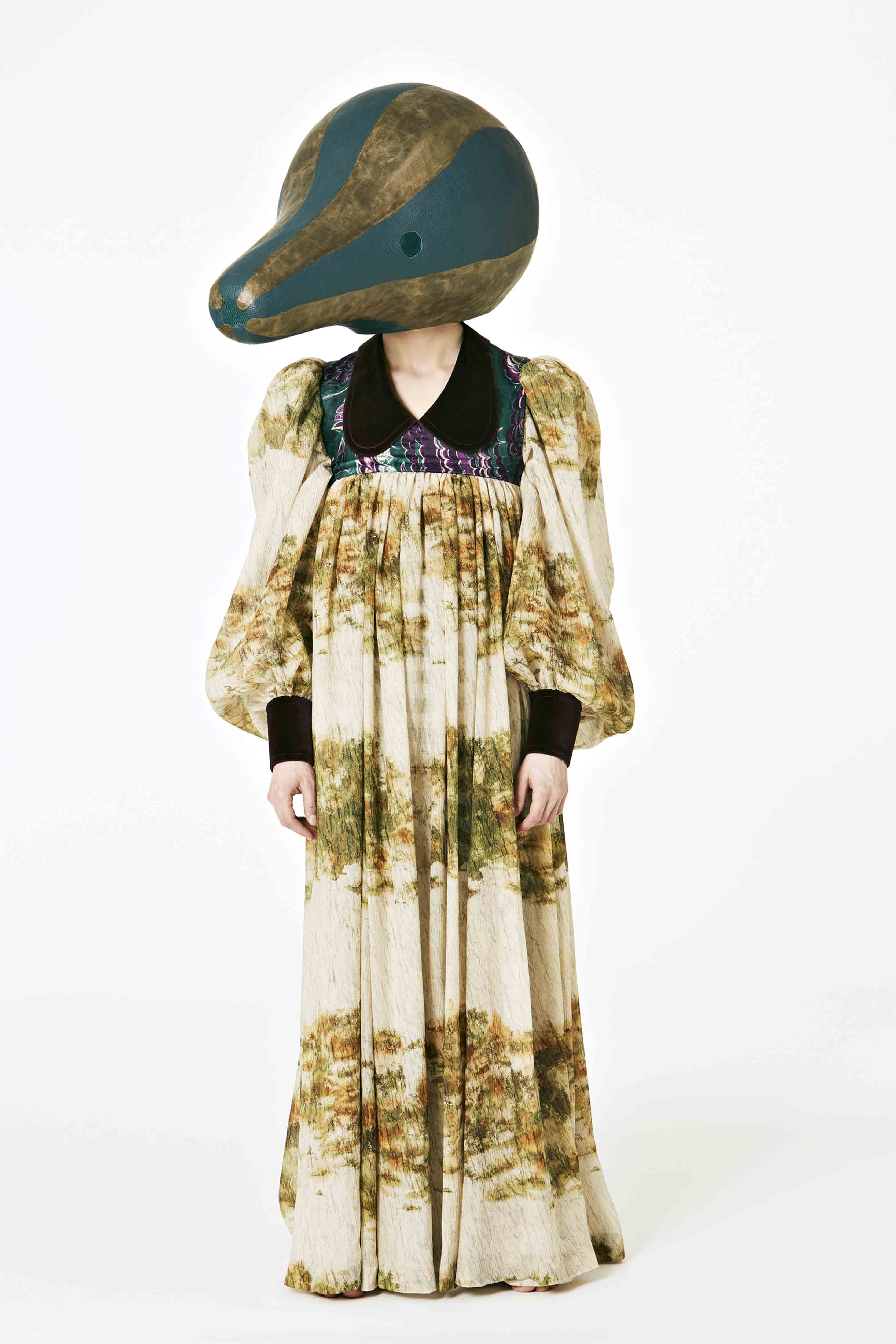 Loewe -Fiber glass head covered in green buffalo leather and vintage effect calf leather. Multicolor printed silk crepon nightgown. Green velvet cuff/collar and purple velvet marble print top panel.
