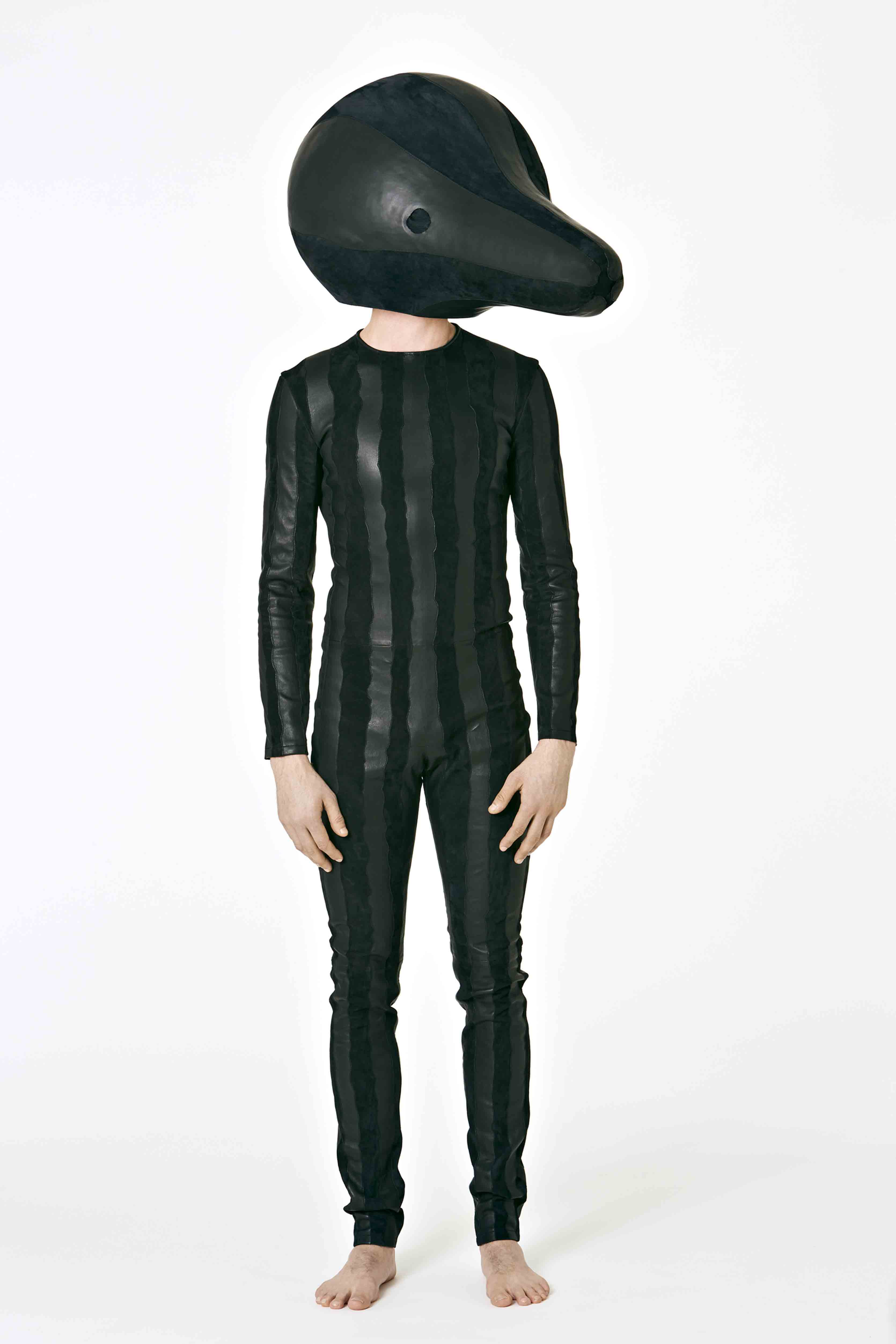 Loewe - Fiber glass head covered in black lamb suede and black strech napa. Tracksuit in black lamb suede and black stretch napa.