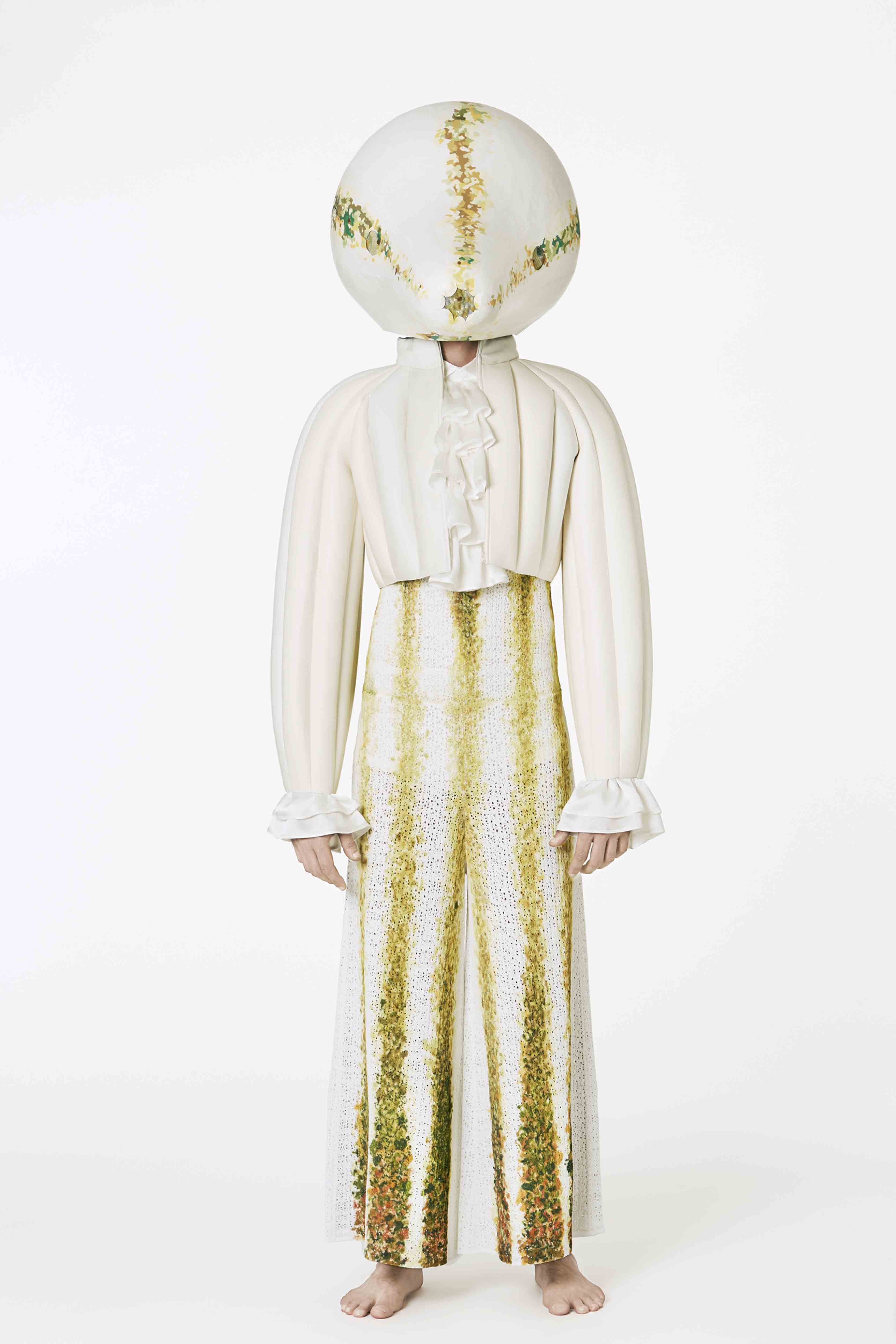 Loewe - Fiber glass head covered in white hand painted napa. White leather bolero.  Tracksuit in white knit with hand painted squash texture.