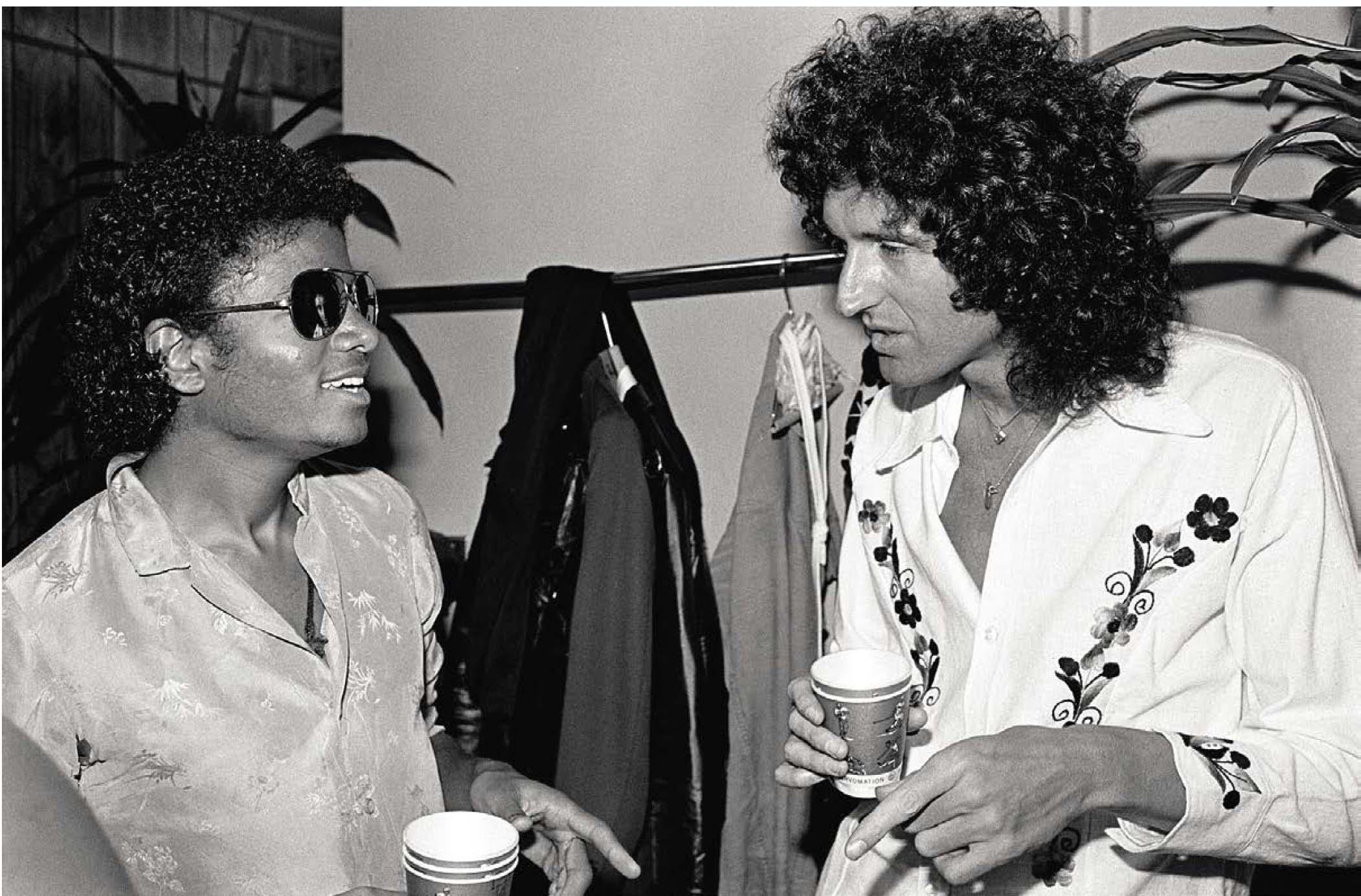 Michael Jackson avec Brian lors d'une soirée d'été en 1983. Neal Preston/Queen Productions Ltd.