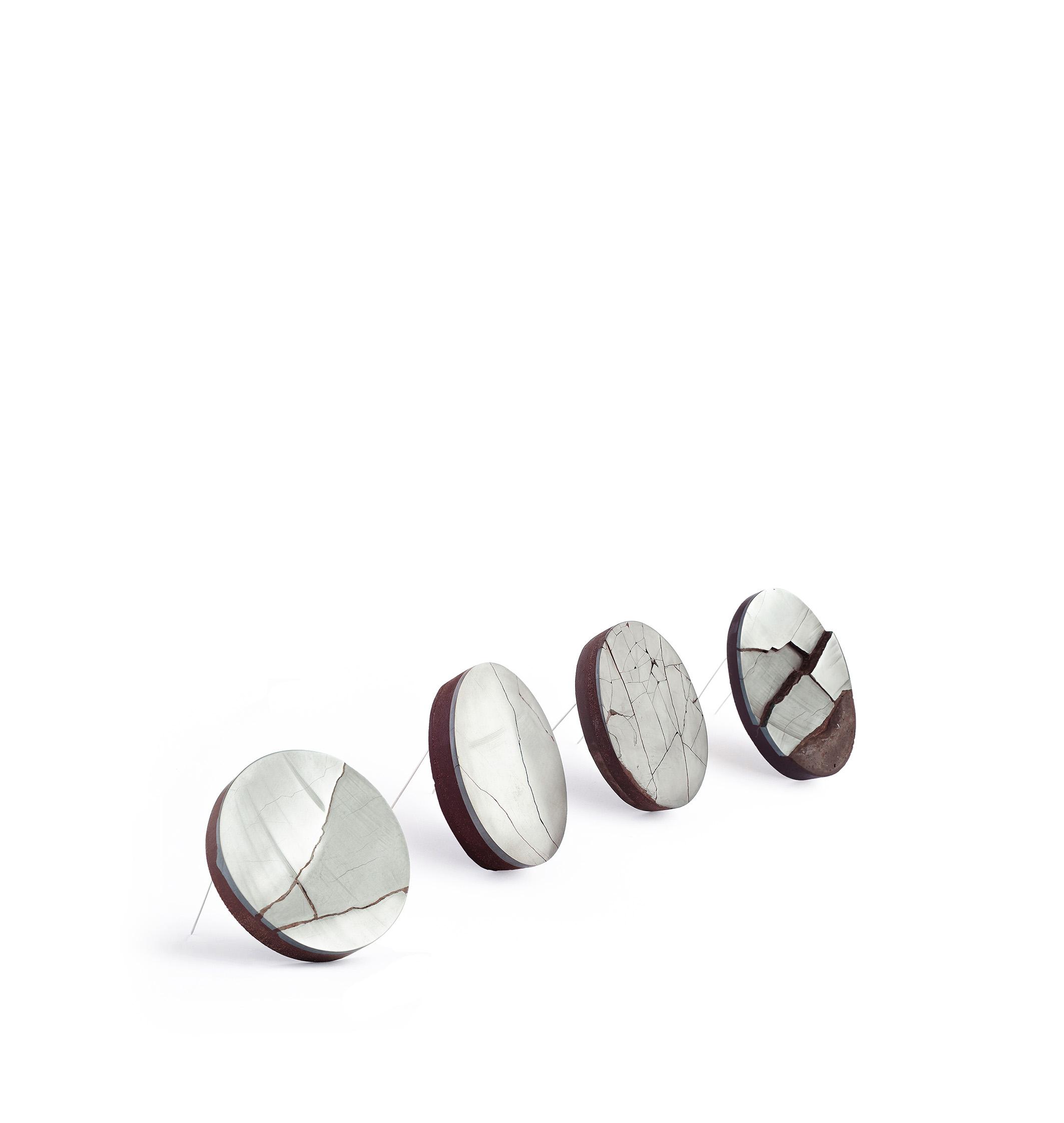 "Sara Gackowska, Poland ""Craquelure"", hematite, stone powder, bio-resin, silver, dimensions variable (2017)"