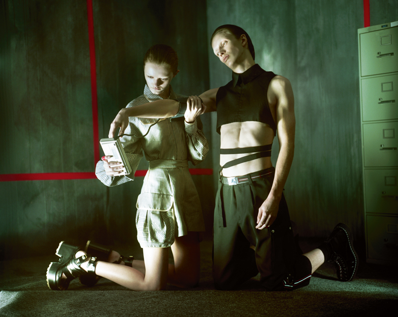 Her: top and short, FENDI. Boots, SACAI X PIERRE HARDY. Him: trouser, belt and socks, DIOR HOMME.Top, ANN DEMEULEMEESTER.