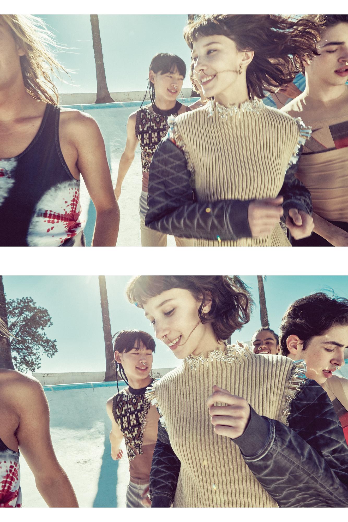 Elle, au centre : robe en laine rebrodée et pull en jersey de coton, LOUIS VUITTON. Lui, à gauche : débardeur en coton à motifs tie and dye, CALVIN KLEIN 205W39NYC. Lui, derrière : haut en polyester et pantalon en laine, CMMN SWDN. Lui, à droite : haut en polyester, CMMN SWDN.