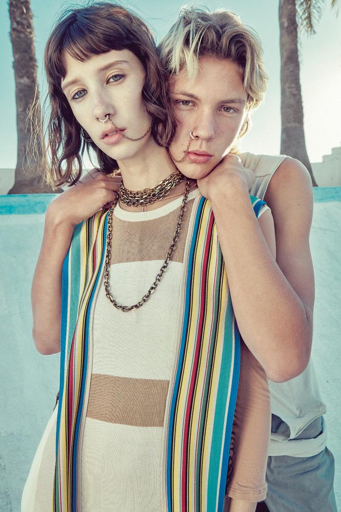 Her: silk knit dress, LOEWE. Him: openwork cotton tank top, RICK OWENS.