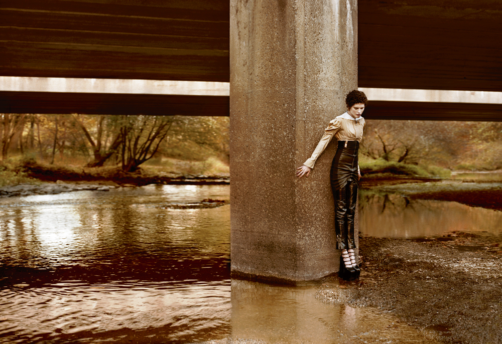 Pleated cotton dress and leather, and polished leather pants, LOUIS VUITTON. Rings, CHRISHABANA. High heels, MARC JACOBS.