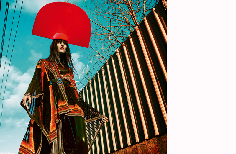 Poncho, BALMAIN. Latex suit, THE BARONESS. Hat and earrings, NEW YORK VINTAGE. Choker and belt, ZANA BAYNE.