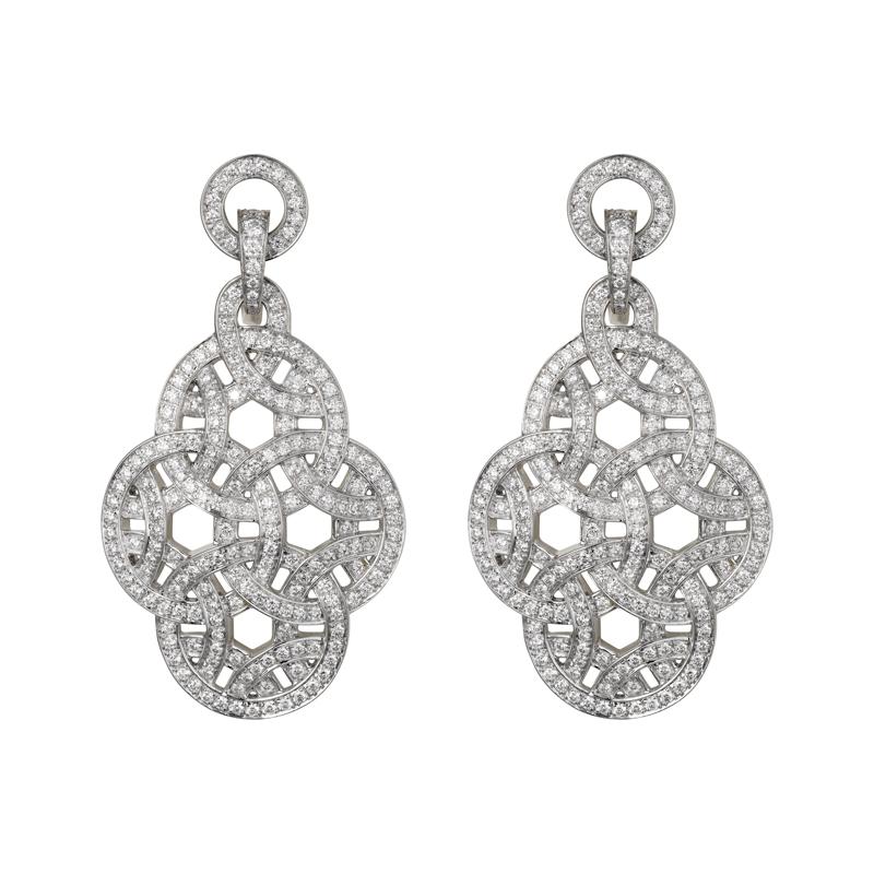 """Boucles d'oreilles """"La Voluptueuse de Cartier"""" en or gris et diamants, CARTIER."""
