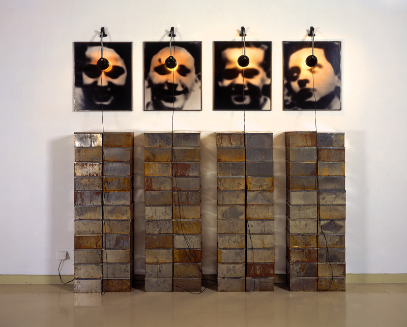 Christian Boltanski, Altar to the Chases High School (Autel Chases), 1987. 4 gelatin silver prints in metal frames, 88 tin boxes, 4 lamps, 223 x 238 cm overall. Gift of Shawn and Peter Leibowitz to American Friends of the Israel Museum, in memory of Charles and Rosalind Leibowitz and Leila Sharenow © The Israel Museum by Meidad Suchowolski.