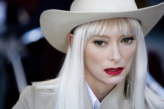"""The Limits of Control"", 2009. More peroxide than normal, Tilda Swinton sparkles in white in the role of Blonde for Jim Jarmusch's thriller. She sports a long almost white mane and her diaphanous skin is adorned only with a dash of scarlet lipstick."