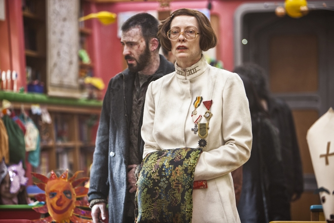 """Snowpiercer"", 2013. Tilda Swinton brings a dose of humour to Joon-ho Bong's dystopian flick. Neither male nor female, the Minister Mason is intriguing in her cool dictator physique. For the occasion she wore a silicon prosthetic and adhesive ribbon was used to change the appearance of her nose, along with dentures and a brown bob, all giving her an ultra-strict appearance."