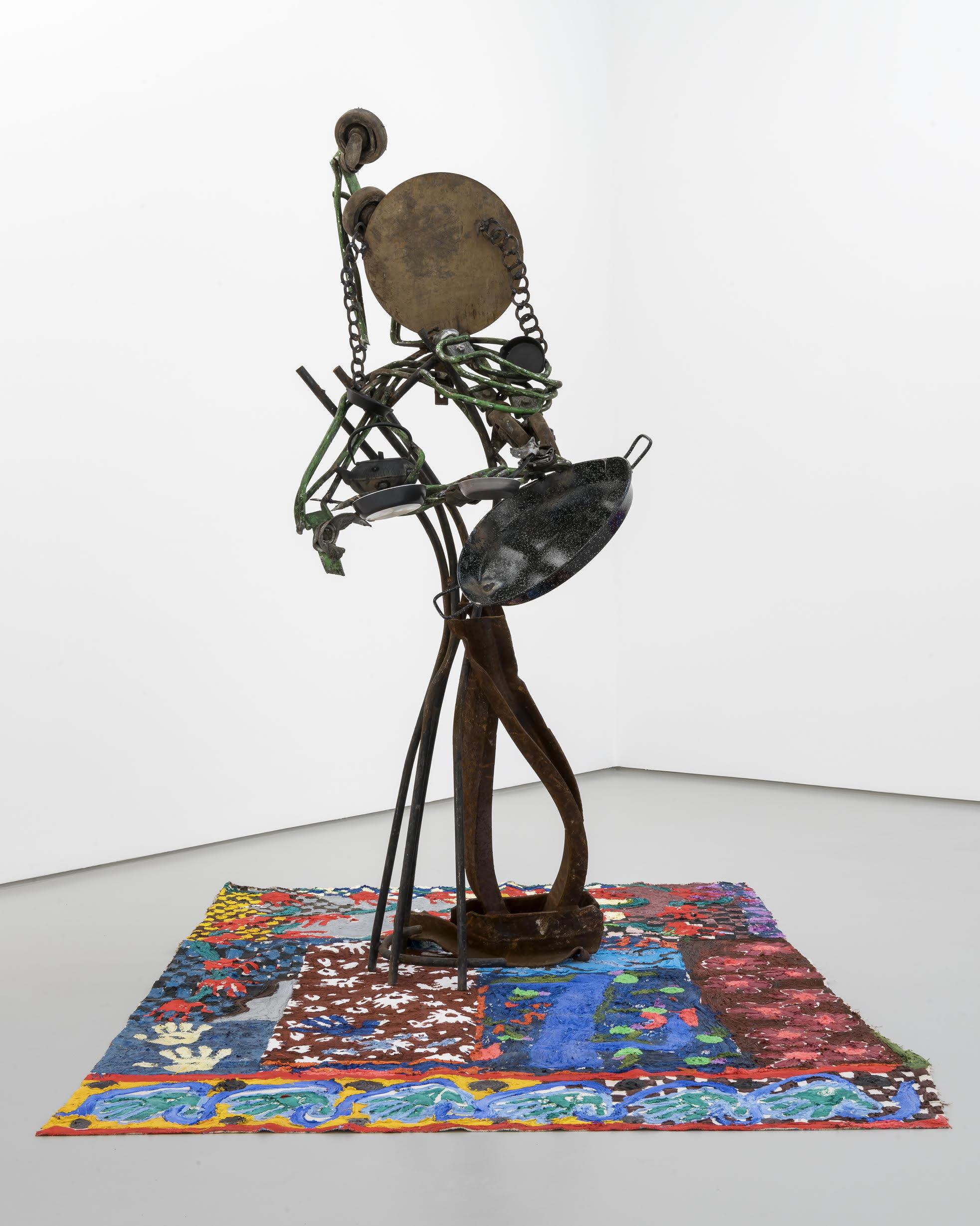 Ida Ekblad - Step Motherfucker, 2017. Welded iron, metal, rubber wheels, plastisol and puff paint on cotton (197 x 85 x 125 cm)