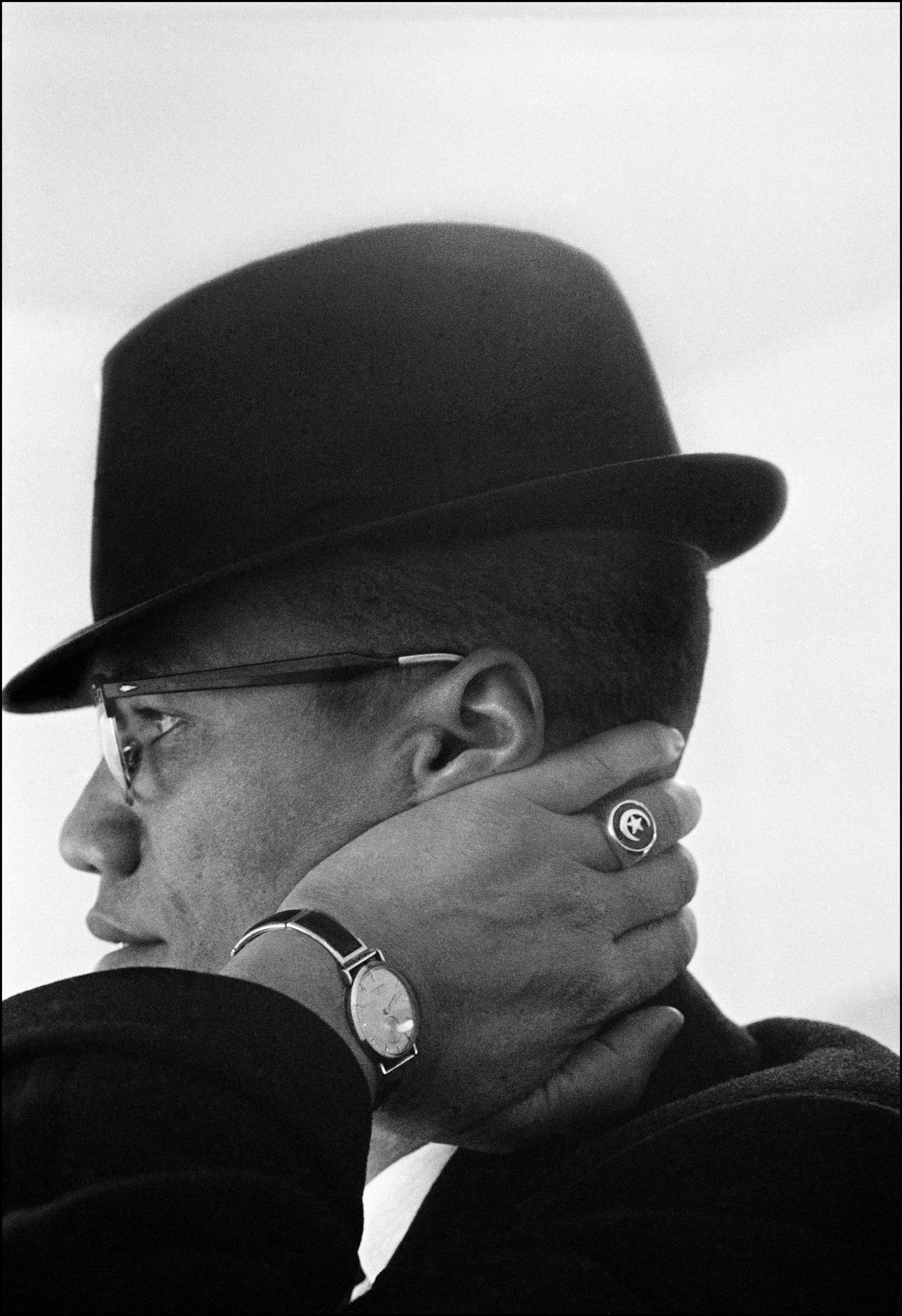 Eve Arnold, USA. Illinois. Chicago. Malcolm X during his visit to enterprises owned by Black Muslims. 1962. Magnum