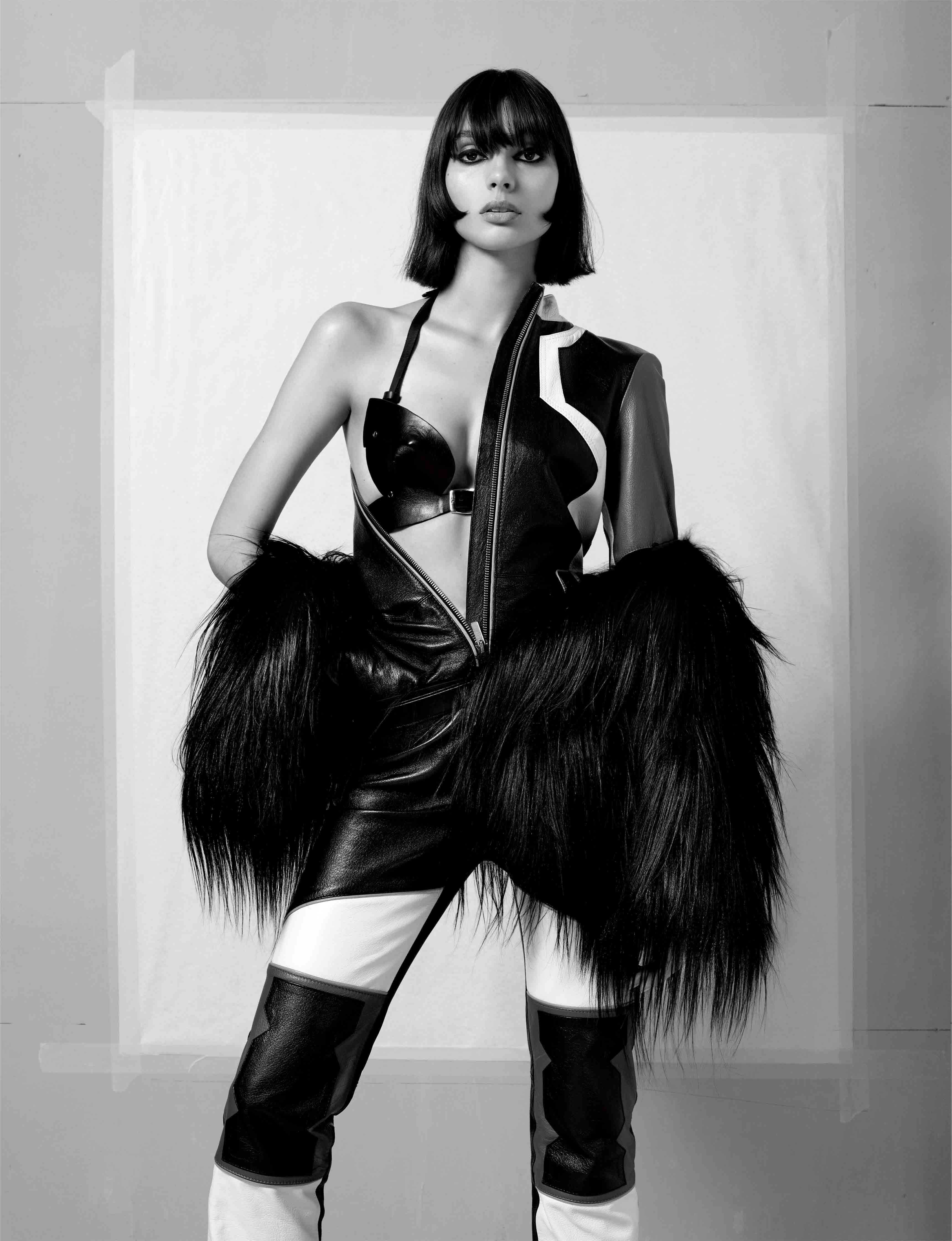 Leather slip with geometrical patterns and fur jacket, DIOR. Leather bra, ZANA BAYNE.