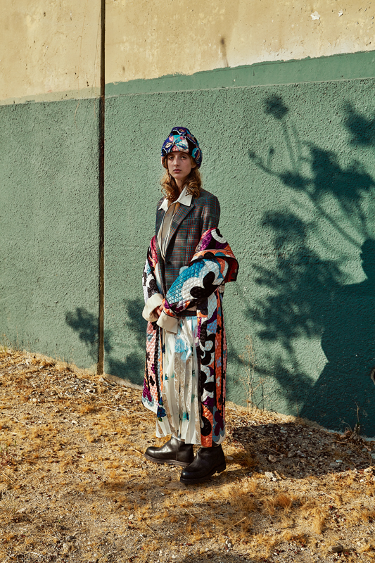 Printed quilted silk coat and hat, EMILIO PUCCI. Wool jacket, GOLDEN GOOSE DELUXE BRAND. Cotton shirt, DRIES VAN NOTEN. Printed pleated silk skirt, MSGM. Boots, CALVIN KLEIN.