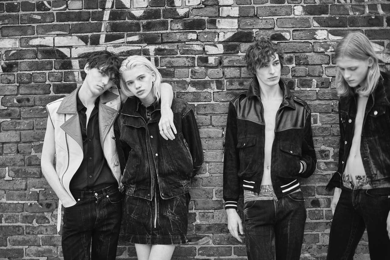 From left to right, him: zipped leather jacket, cotton veil shirt and jeans, GIVENCHY. Her: superposition of jackets and denim mini-skirt, GIVENCHY. Him: Leather and suede jacket, and jeans, GIVENCHY. Him: denim jacket and jeans, GIVENCHY.