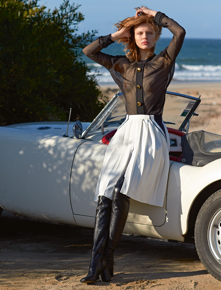Blouse and skirt, PRADA. Thigh-high boots, SAINT LAURENT BY ANTHONY VACCARELLO.
