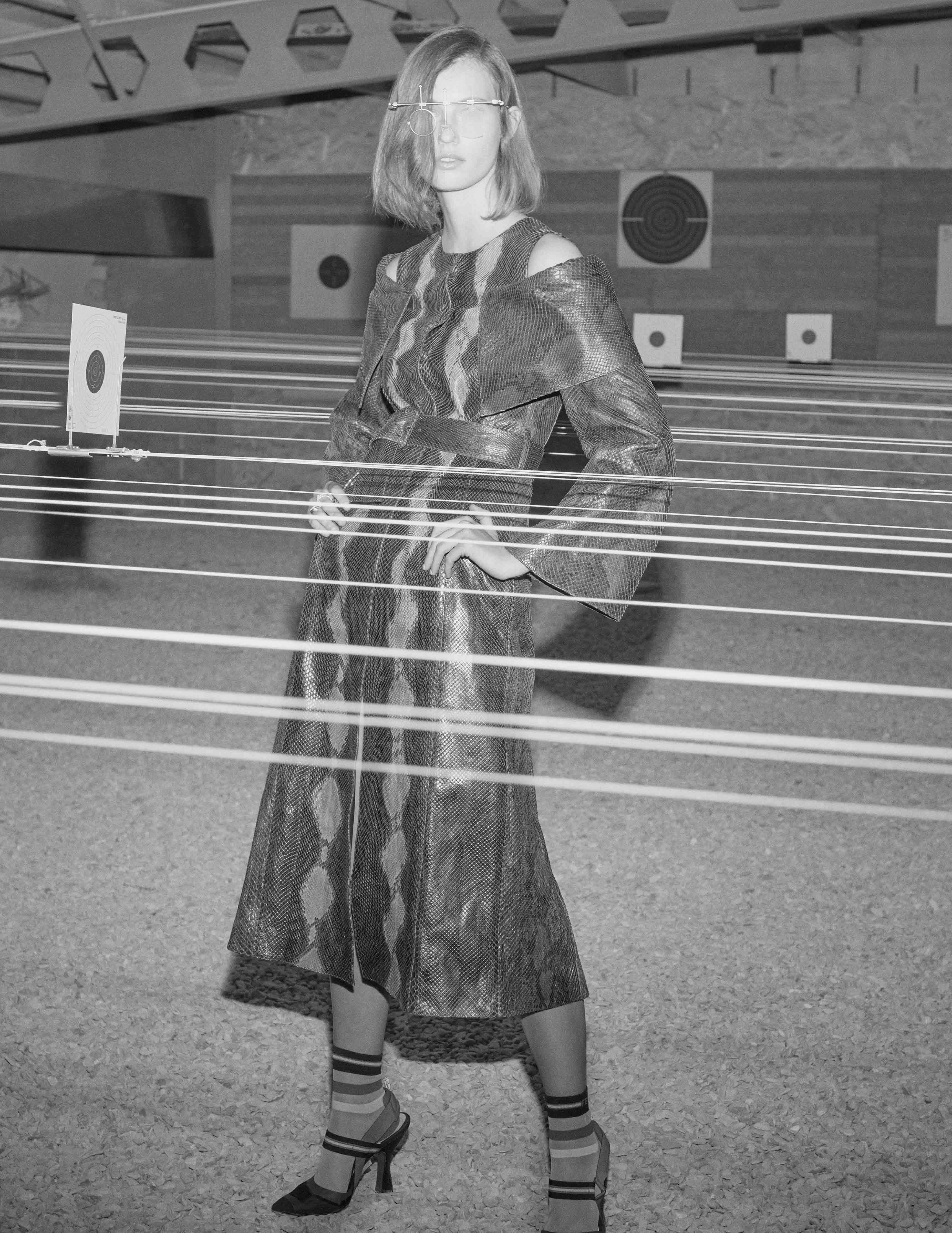 "Python dress-coat, socks and shoes, FENDI. ""Antifer"" rings, REPOSSI. Shooting glasses, CLUB ASCV."