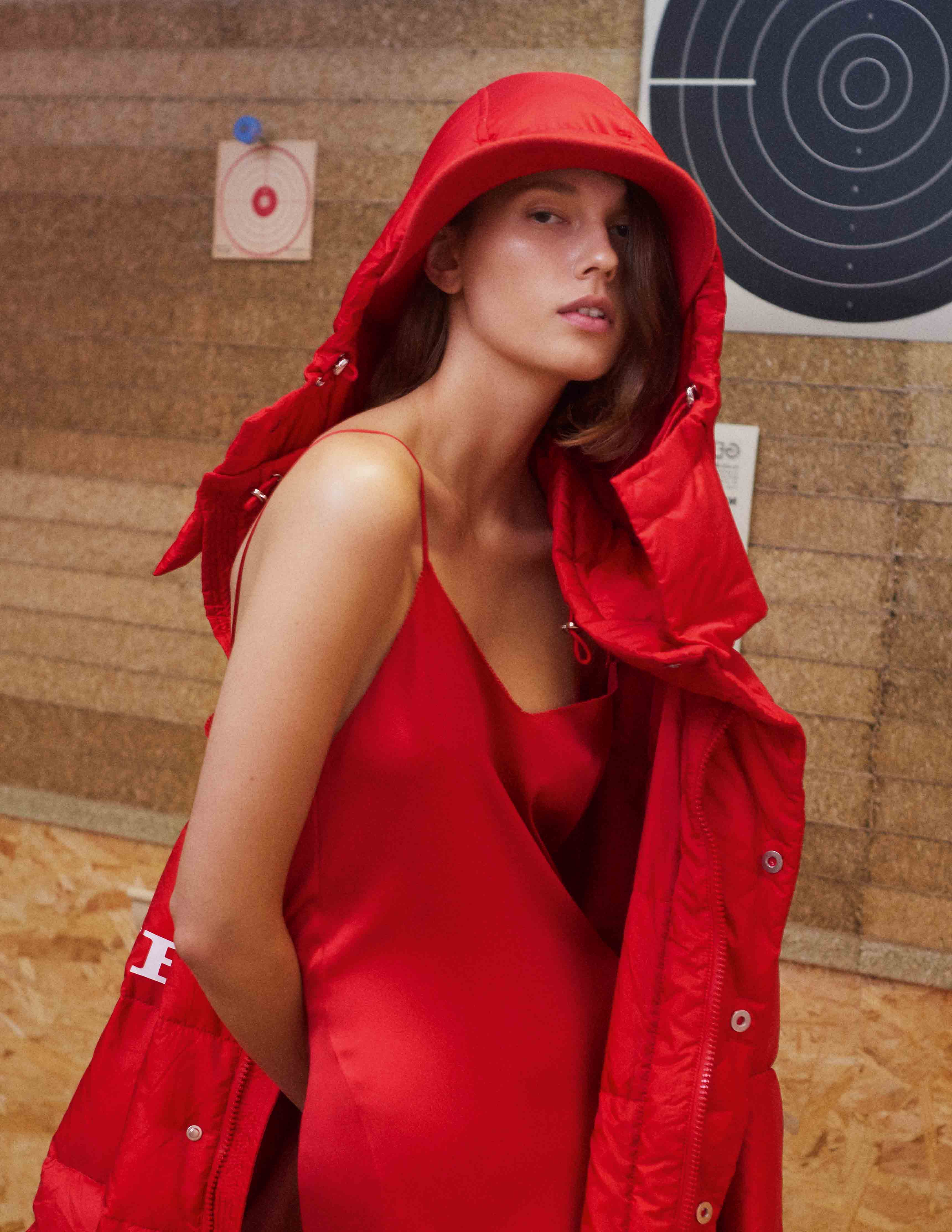 Bomber jacket in technical material and satin silken dress, ERMANNO SCERVINO. Hat, ANTHONY PETO.